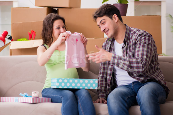Young couple of man and pregnant wife with giftbox Stock photo © Elnur