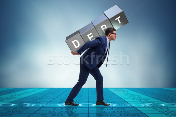 Businessman under heavy debt burden Stock photo © Elnur