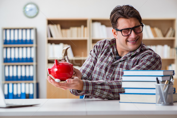 The student breaking piggybank to pay for tuition fees Stock photo © Elnur