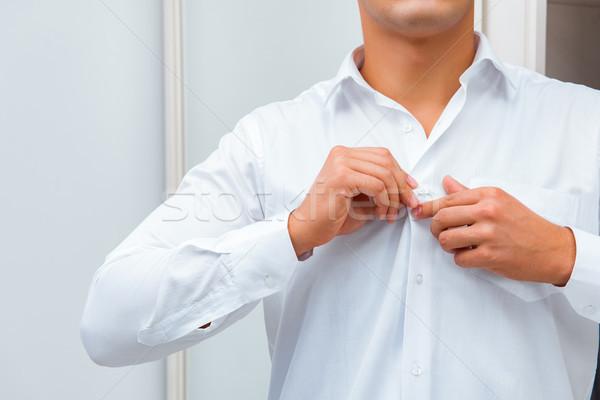 бизнесмен одевание вверх работу бизнеса стороны Сток-фото © Elnur