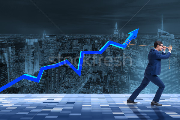 The businessman supporting increase in economy Stock photo © Elnur