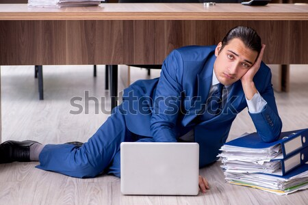 Drug addict businessman in the office Stock photo © Elnur