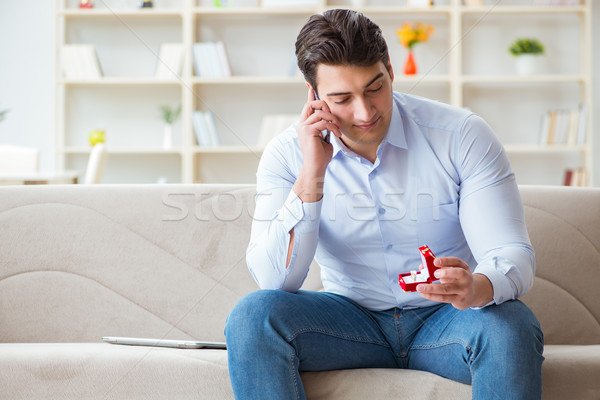 Young man chatting with his sweetheart over mobile phone Stock photo © Elnur