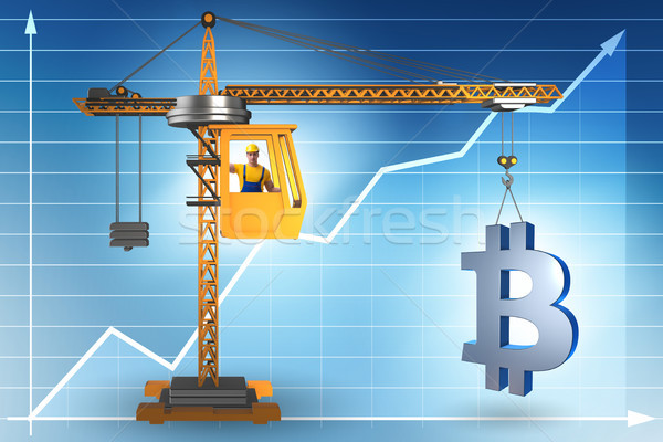 Construction crane lifting bitcoin in cryptocurrency concept Stock photo © Elnur
