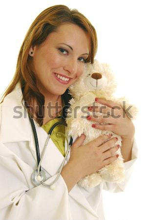 Sonriendo médico femenino aislado blanco mujer Foto stock © elvinstar