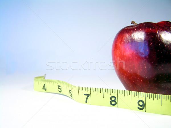 リンゴ 巻き尺 白 巻き尺 重量 を見て ストックフォト © elvinstar