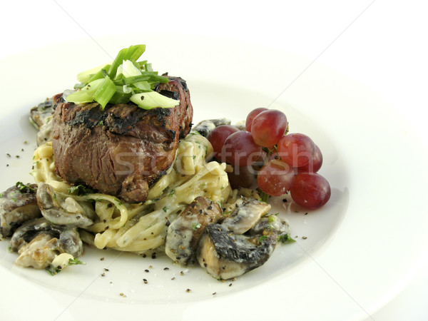Filet mignon over pasta Stock photo © elvinstar
