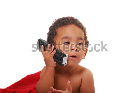 Multi Racial Baby Wrapped In A Blanket Playing With A Phone Stock