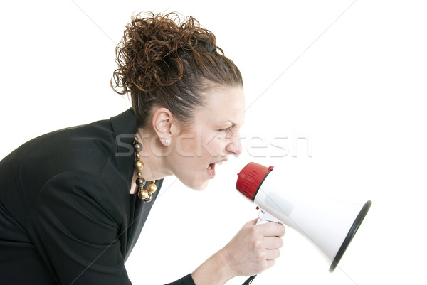 Business woman yelling into a bullhorn Stock photo © elvinstar
