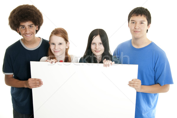 Stock photo: Teens with blank sign