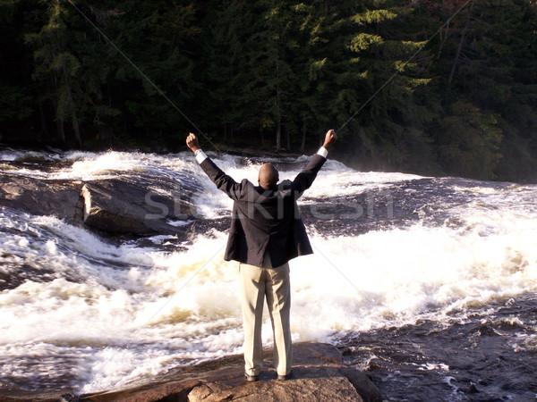 торжествующий деловой человек костюм сотового телефона Постоянный реке Сток-фото © elvinstar
