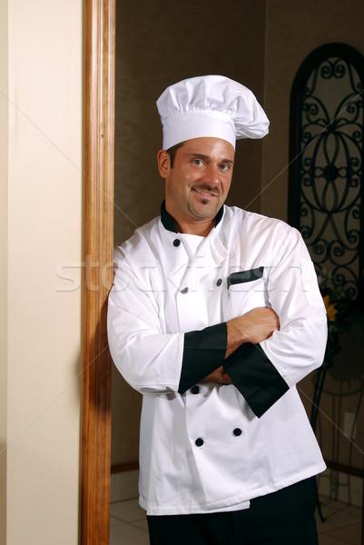 笑みを浮かべて シェフ 魅力的な 白人 立って ストックフォト © elvinstar