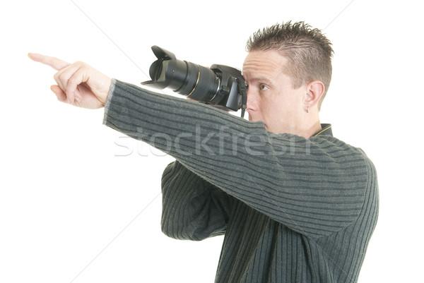 Fotógrafo senalando jóvenes masculina puntos Foto stock © elvinstar