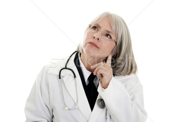 Maduro femenino médico estetoscopio aislado blanco Foto stock © elvinstar