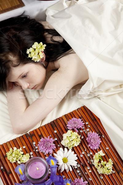 Espera massagem jovem caucasiano mulher mentiras Foto stock © elvinstar