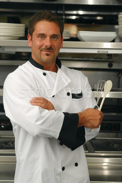 Sorridente chef atraente caucasiano em pé Foto stock © elvinstar