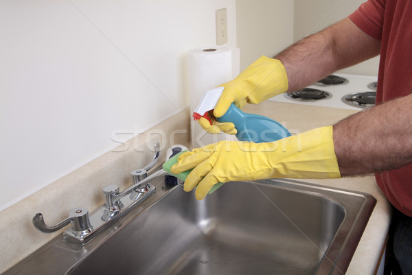 Man cleaning the sink Stock photo © elvinstar