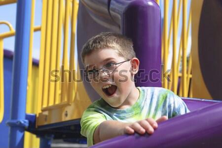 Boy at the playground Stock photo © elvinstar