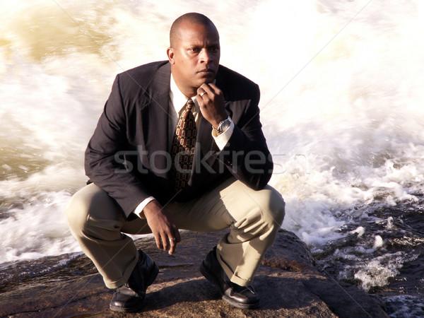 Pensando homem de negócios terno para baixo rio amarrar Foto stock © elvinstar