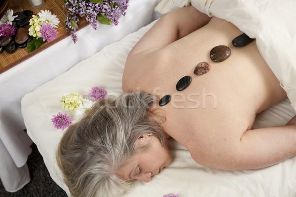 Caliente piedra caucásico mujer mentiras masaje Foto stock © elvinstar