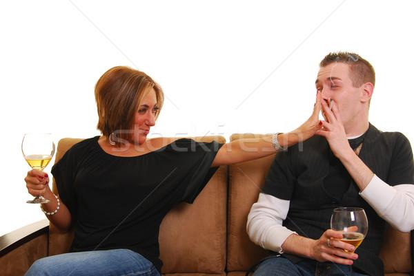 Pareja sofá hombre fumar mujer Foto stock © elvinstar