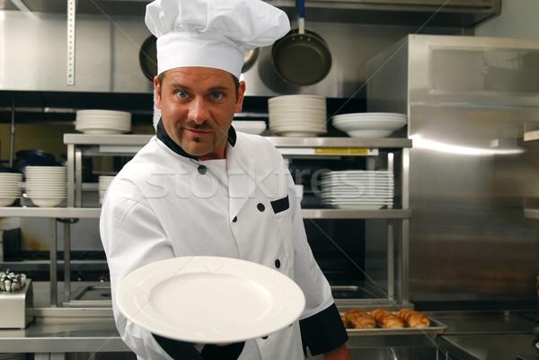 Sorridente chef vazio prato atraente caucasiano Foto stock © elvinstar