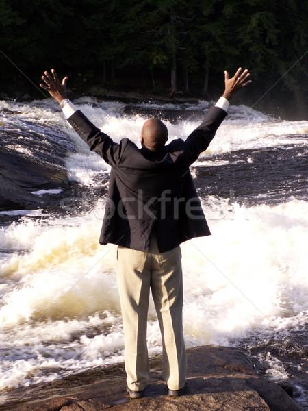 свободный деловой человек костюм Постоянный реке рук Сток-фото © elvinstar
