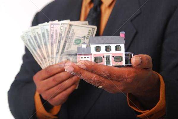 Otthon tőke férfi kezek tart miniatűr Stock fotó © elvinstar