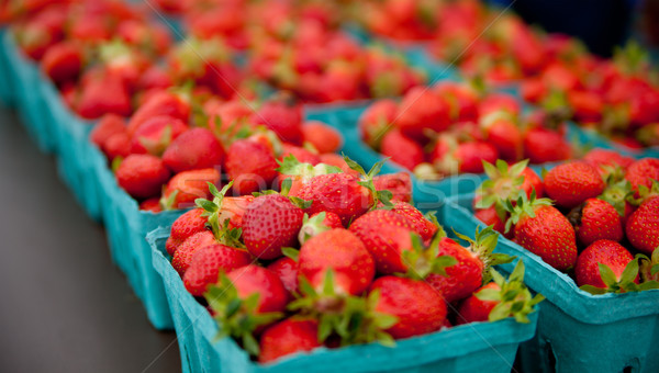 Containers of strawberries at a farmers market Stock photo © elvinstar