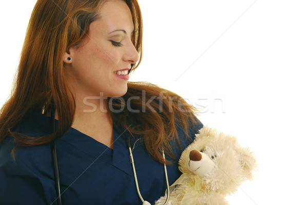 Enfermeira atraente caucasiano recheado animal Foto stock © elvinstar