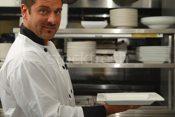 Sonriendo chef vacío placa atractivo caucásico Foto stock © elvinstar
