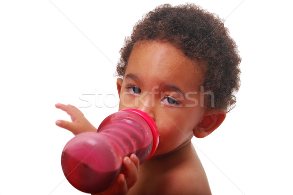 Multi-racial baby drinking Stock photo © elvinstar