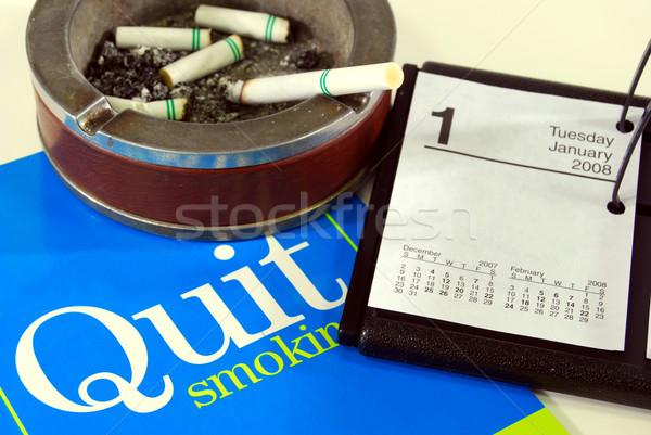 Nuevos año cigarrillo cenicero encendedor Foto stock © elvinstar