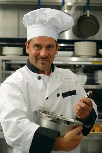 Chef mixing food Stock photo © elvinstar
