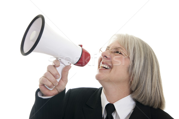 Business woman speaking into a bullhorn Stock photo © elvinstar