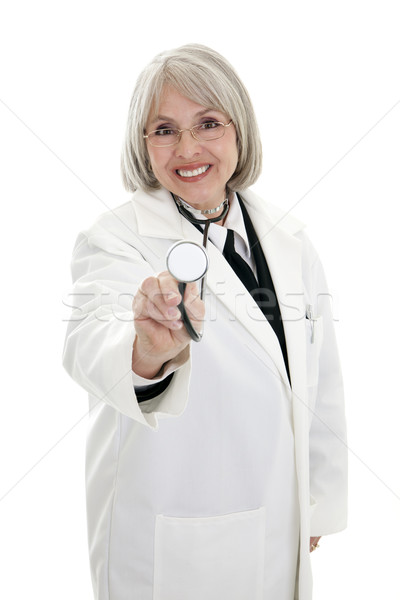 érett női orvos fókuszált sztetoszkóp izolált Stock fotó © elvinstar