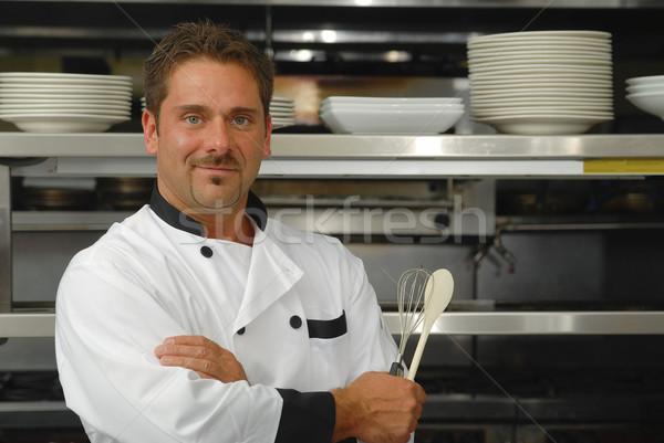 Sonriendo chef atractivo caucásico pie los brazos cruzados Foto stock © elvinstar