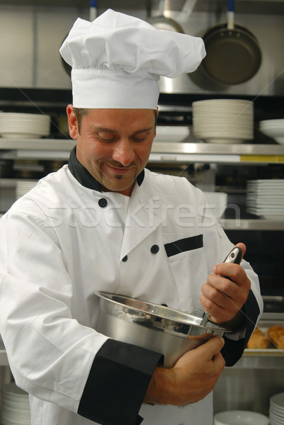Chef mixing food Stock photo © elvinstar
