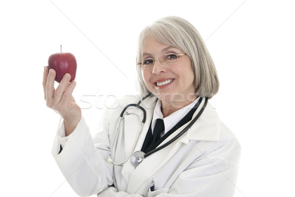 Manzana día maduro femenino médico Foto stock © elvinstar