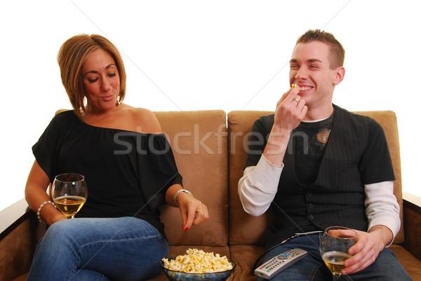Foto stock: Filme · noite · casal · sofá · alimentação · mulher