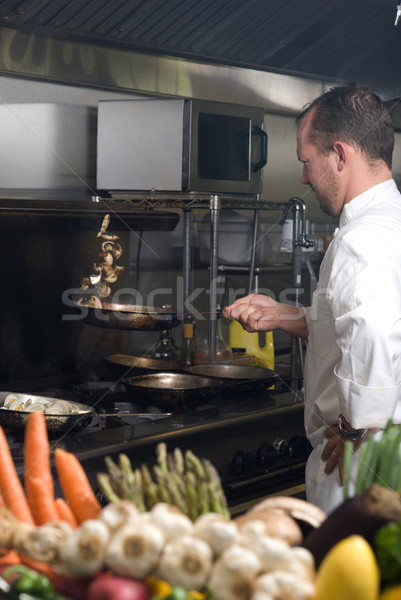 Chef flipping mushrooms Stock photo © elvinstar