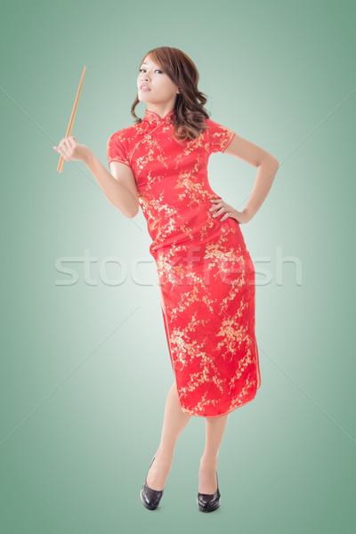 Китайский Новый год палочки для еды улыбаясь китайский женщину платье Сток-фото © elwynn