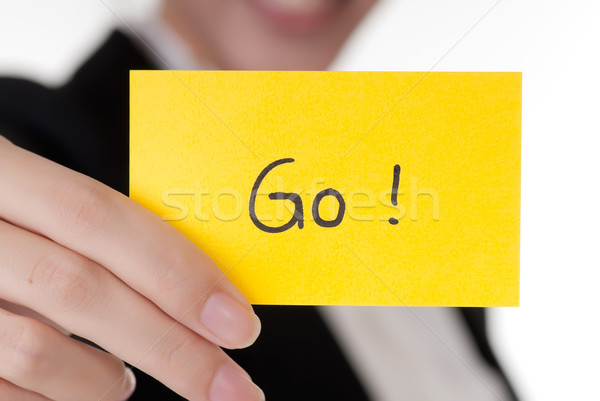 'Go' on business card holding by Asian businesswoman. Stock photo © elwynn
