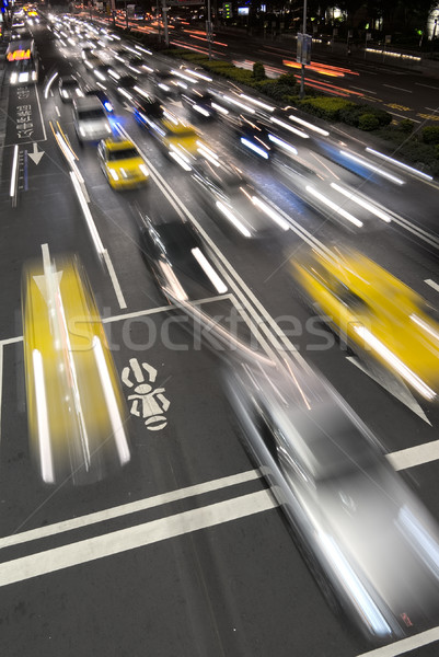 автомобилей движения расплывчатый современных ночному городу автомобилей Сток-фото © elwynn