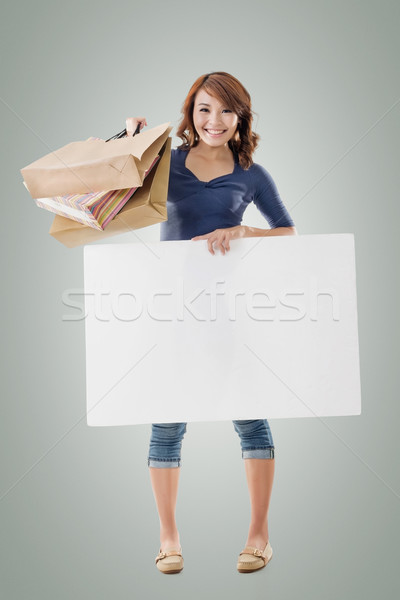 Shopping woman holding bags and blank board Stock photo © elwynn