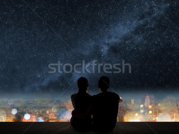 couple sit under strars Stock photo © elwynn