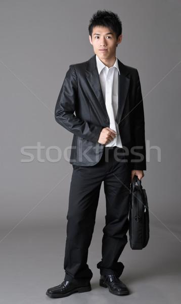 Niedojrzały człowiek biznesu asian studio szary biuro Zdjęcia stock © elwynn