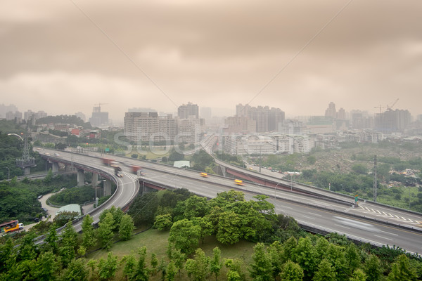 Kötü hava Cityscape gün batımı karayolu binalar hava Stok fotoğraf © elwynn