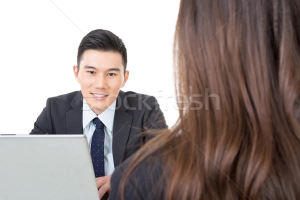 азиатских молодые деловой человек Consulting женщину Сток-фото © elwynn
