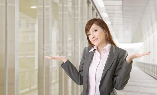 Indifeso segno giovani donna d'affari spalle bianco Foto d'archivio © elwynn